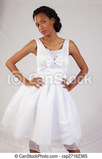 Pretty black woman in white dress - csp27162365