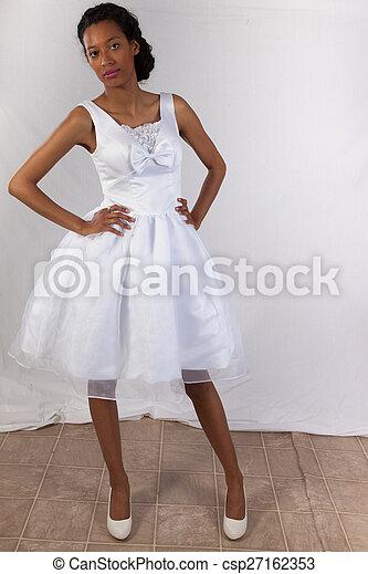 Pretty black woman in white dress - csp27162353