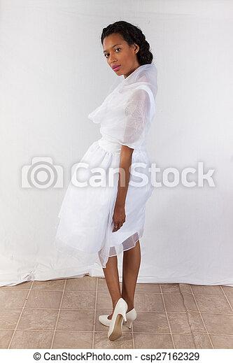 Pretty black woman in white dress - csp27162329