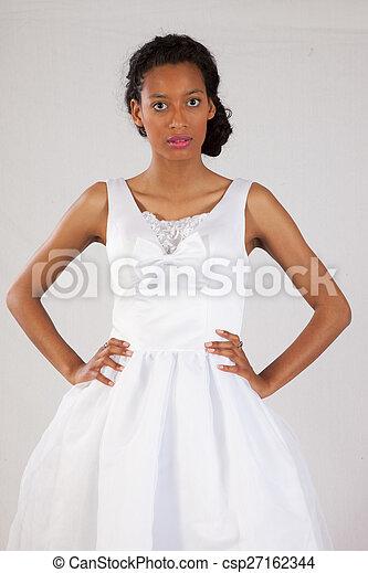 Pretty black woman in white dress - csp27162344