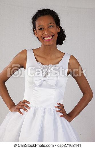 Pretty black woman in white dress - csp27162441