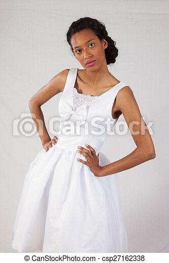 Pretty black woman in white dress - csp27162338