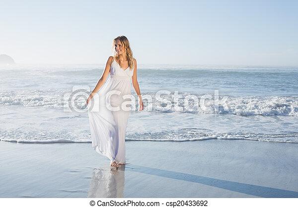 Pretty blonde at the beach in white - csp20433692