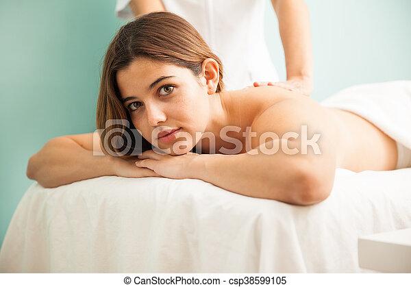 Pretty brunette getting a massage - csp38599105