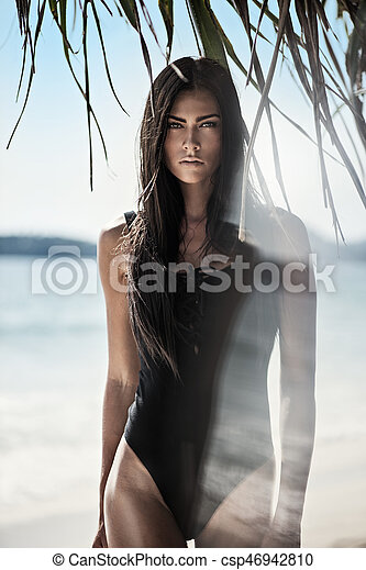 Pretty brunette lady on the tropical beach - csp46942810