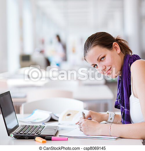 pretty female college student studying in the university library/study room (color toned image) - csp8069145