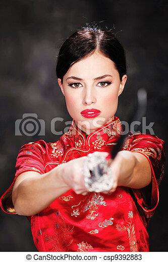 Pretty female katana warrior - csp9392883