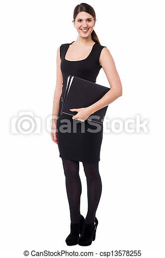 Pretty female secretary holding business files - csp13578255