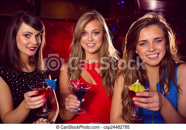 Pretty friends drinking cocktails together - csp24482785