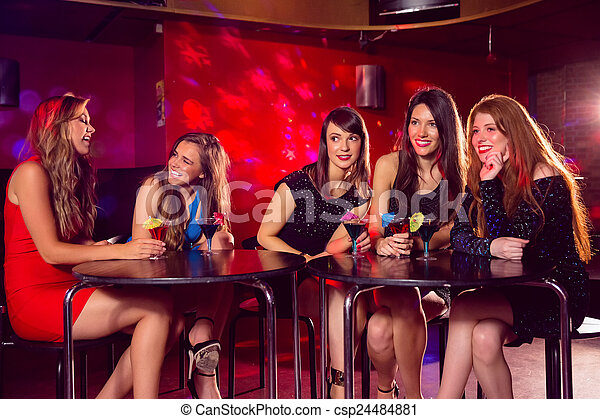 Pretty friends drinking cocktails together - csp24484881