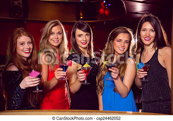 Pretty friends drinking cocktails together - csp24462052