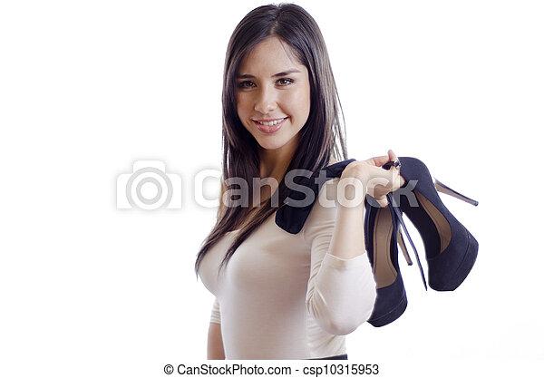 Pretty girl holding her heels - csp10315953