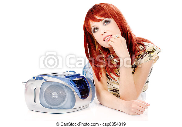 Pretty girl laying and listening music - csp8354319