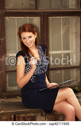 Pretty girl with clipboard and pen. - csp42111645