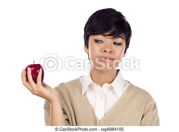 Pretty Hispanic Young Adult Female Looking at Apple - csp6984105