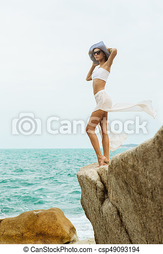 Pretty lady in summer outfit on the beach. Beautiful girl in white ... 403ea52afce3