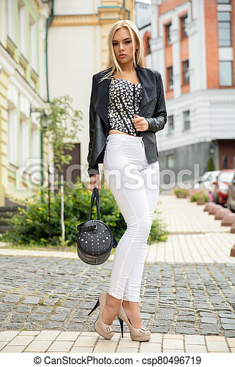 Pretty lady posing on the street - csp80496719