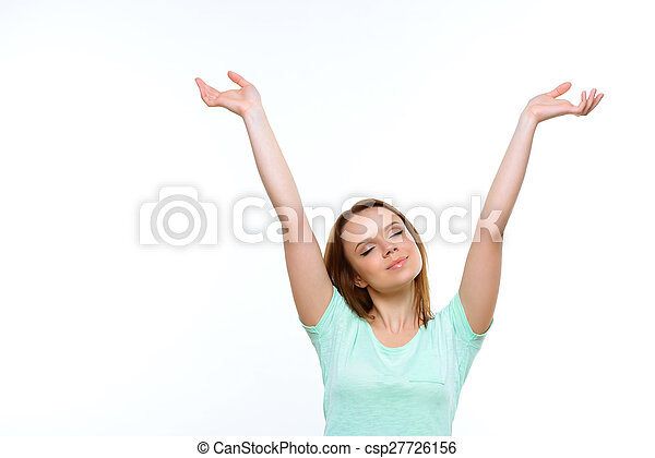 Pretty lady with closed eyes holding hands up - csp27726156