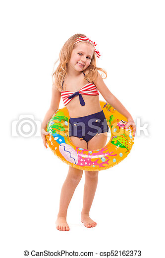 Pretty little girl in red striped bikini, blue bottoms and pink wreath stand stand with colorful rubber ring on the waist - csp52162373