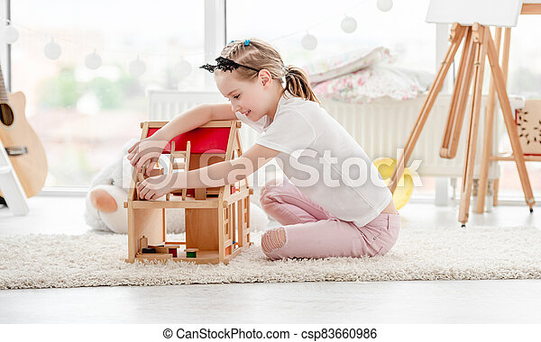 Pretty Little Girl Playing With Dollhouse Plays Wooden In Children S Room Canstock