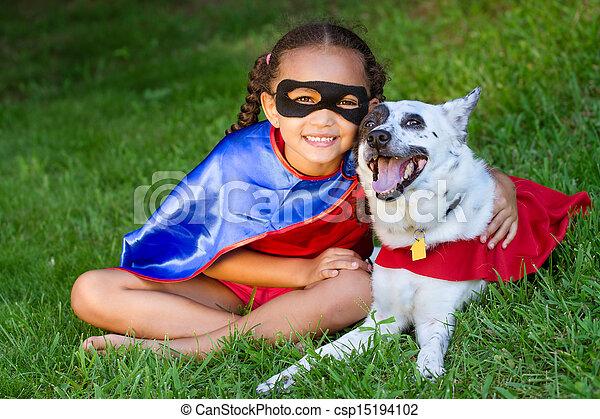 Pretty mixed race girl hugging pet - csp15194102