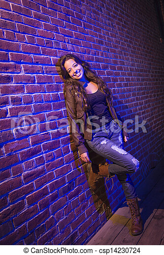 Pretty Mixed Race Young Adult Woman Against a Brick Wall - csp14230724