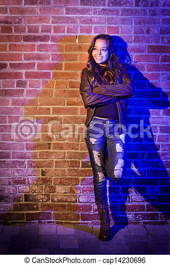 Pretty Mixed Race Young Adult Woman Against a Brick Wall - csp14230696