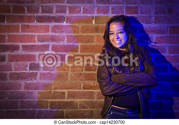 Pretty Mixed Race Young Adult Woman Against a Brick Wall - csp14230700