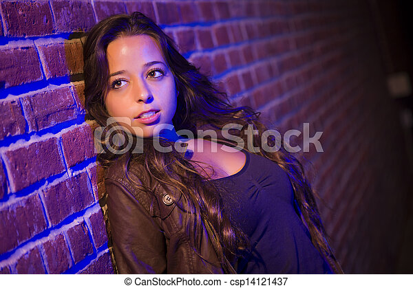 Pretty Mixed Race Young Adult Woman Against a Brick Wall - csp14121437