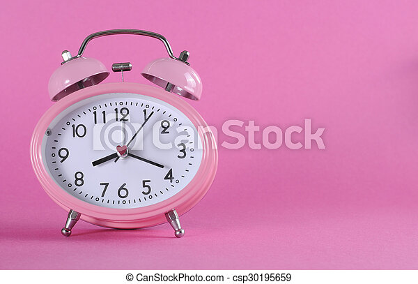 8698483e21f5d9 Pretty pink vintage retro style alarm clock with copy space on pink  background for daylight saving