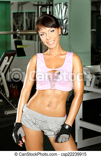 pretty sophisticated fitness model trains in the gym - csp22239915