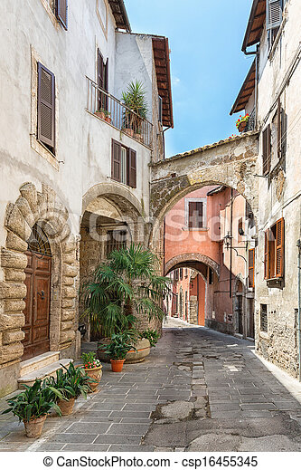 Pretty street in the ancient city of Tuscany - csp16455345