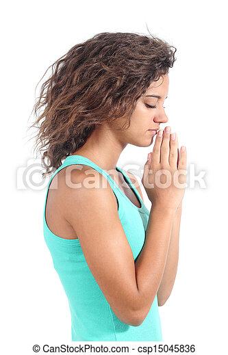Pretty teenager girl praying - csp15045836
