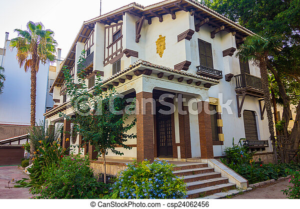 Pretty white house with wood - csp24062456