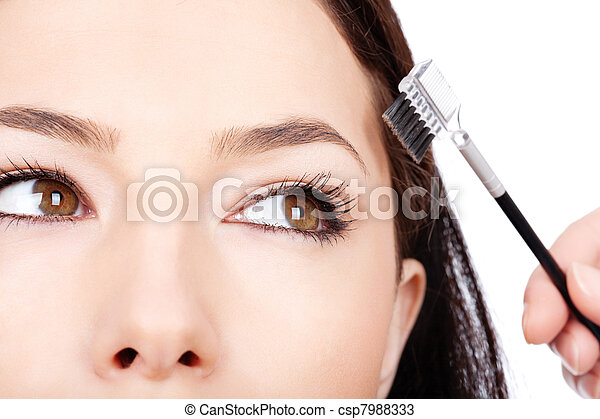 pretty woman applying make up - csp7988333