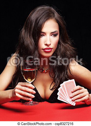 pretty woman gambling on red table - csp8327216