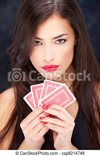 Pretty woman holding cards - csp8214748
