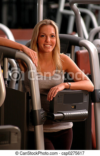 pretty woman in fitness center - csp0275617