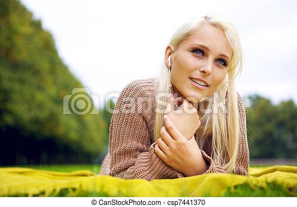 Pretty woman in park - csp7441370