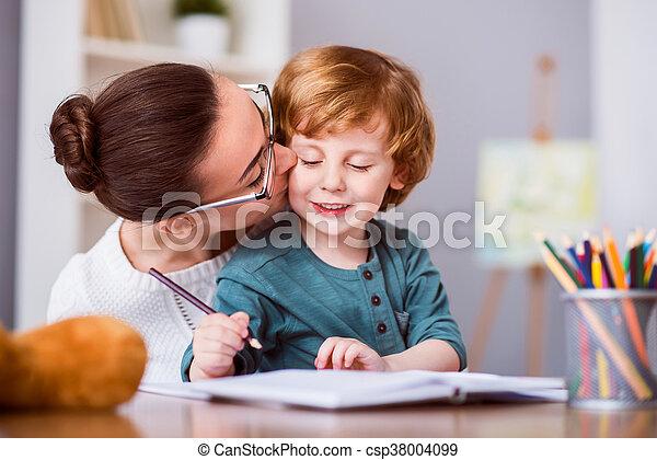 Pretty woman kissing her son - csp38004099