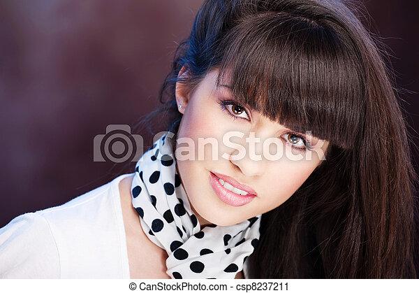 Pretty woman on dark background - csp8237211