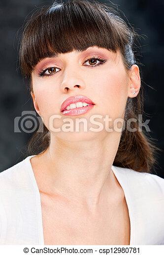 Pretty woman on dark background - csp12980781