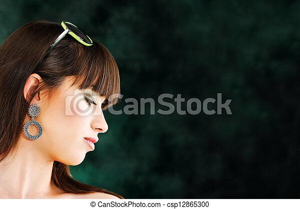 Pretty woman on dark background - csp12865300