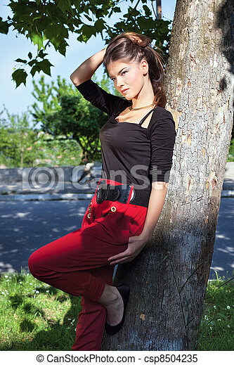 Pretty woman on sunny day in park - csp8504235