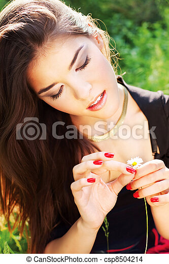 Pretty woman on sunny day in park - csp8504214