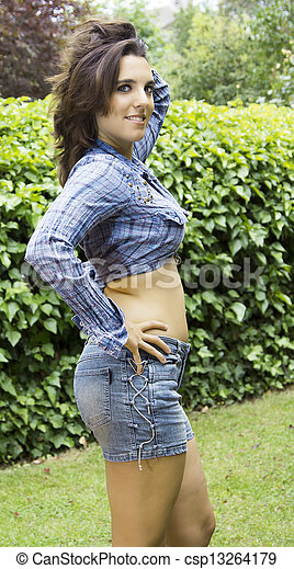 pretty woman posing green leaves background - csp13264179