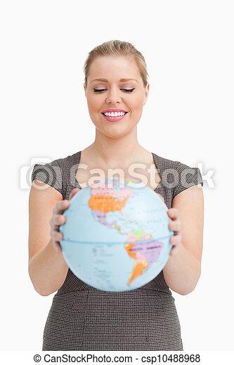Pretty woman showing a globe  - csp10488968