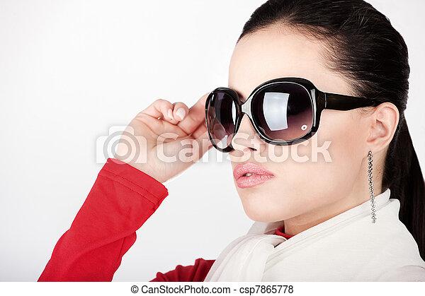 Pretty woman with big sun glasses - csp7865778