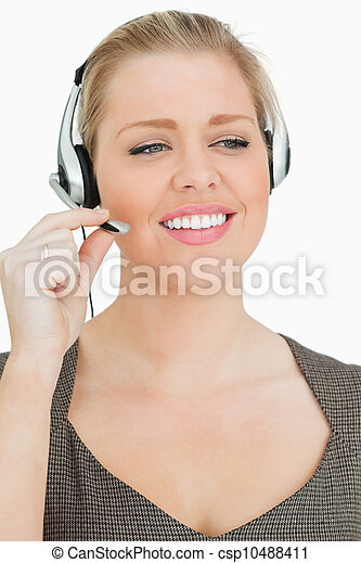 Pretty woman working in a call center - csp10488411