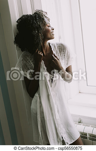 Pretty young african american woman - csp56550875